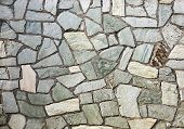 image of tile cladding  - section of flagstone wall with varying shapes and lines - JPG