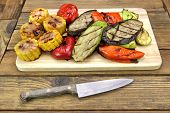 picture of sweet-corn  - Kitchen Knife and Grilled Vegetables Assortment On The Wood Cutting Board - JPG