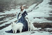 stock photo of coat  - The woman in blue coat walk with a dog - JPG