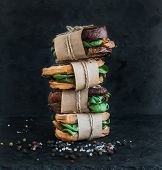 picture of sandwich  - Cured chicken and spinack whole grain sandwich tower with spices and black stone background - JPG