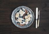 image of maple syrup  - Breakfast set on dark wooden desk - JPG