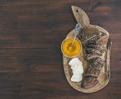 pic of brie cheese  - Breakfast set on a dark wood background - JPG