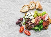 pic of baguette  - Wine set consisting of smoked meat sausages cheese grapes cherry - JPG