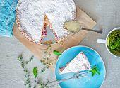 stock photo of custard  - Custard cherry pie tea and herbs on the table - JPG