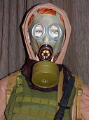 image of tommy-gun  - Military mannequin with gass mask and hood - JPG