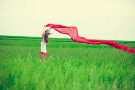 image of slim model  - Young lady runing with tissue in green field - JPG