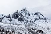 Dramatic Mountain View Of Ama Dablam After A Heawy Snowfall On The Famous Everest Base Camp Trek In poster