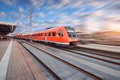 Постер, плакат: Red Modern High Speed Train In Motion