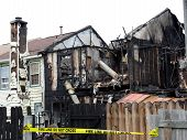 stock photo of mayhem  - Remains of a house fire in Virginia Beach Virginia  - JPG
