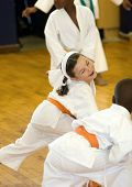 stock photo of karate kid  - Small karate girl training in the dojo - JPG