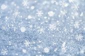 light blue snowflakes and glitter sparkles background , super macro shot, shallow DOF