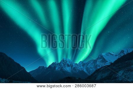 Aurora Borealis Above Snow Covered