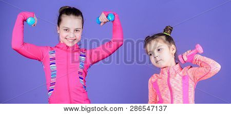 poster of Fit Cuties. Small Girls Enjoy Fitness Training With Weights. Cute Sisters Doing Gym Fitness Exercise