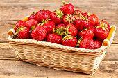 Fresh Juicy Strawberries In Basket. Wicker Basket Full Of Freshly Picked Strawberries On Vintage Woo poster