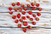Ripe Strawberries Arranged In Heart Shape. Heart Made Of Ripe Sweet Berries On Old Wooden Surface. F poster