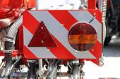 Warning Sign Lights With Safety Signal Reflector Plate At Agricultural Machine poster