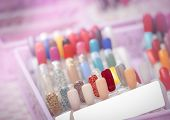 Colorful Artificial Nails In Nail Salon Shop. Set Of False Nails For Customer To Choose Color For Ma poster