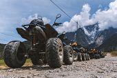 Atv (all-terrain Vehicle) Parked On Dirt Gravel Road With View Of Mount Kinabalu At Kundasang Sabah. poster