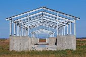 New Construction. The Frame Of The New Building Is Made From The Metal Frame And Concrete. Steel Con poster
