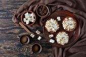 Lemon Meringue Tartlets With Browned Meringue Peaks Served With Coffee, Mini Marshmallows And Brown  poster