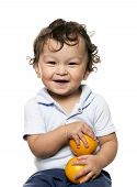 pic of healthy food  - The child with an oranges in a hand - JPG