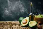 Avocado And Avocado Oil On A Wooden Background. Copy Space. poster