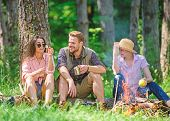Camping And Hiking. Halt For Snack During Hiking. Company Friends Relaxing And Having Snack Picnic N poster
