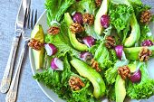 Salad With Avocado, Blue Onion And Walnut. Super Nutritious Fitness Salad With Avocado. Vegan Salad. poster