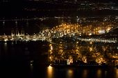 Aerial night photo of the port of Oakland, California in San Francisco Bay. poster