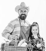 Father Farmer Or Gardener With Daughter Hold Basket Harvest Vegetables. Gardening And Harvesting. Fa poster