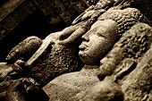 stock photo of ellora  - Buddha sculpture in the magnificent archeological site of Ellora Caves - JPG