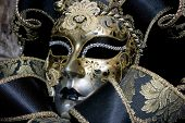 foto of mardi-gras  - Close up of Venetian mask on black background - JPG