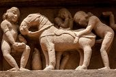 stock photo of kamasutra  - Famous erotic stone carving bas relieves - JPG