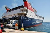 ALONISSOS, GREECE - SEPTEMBER 27, 2012: Hellenic Seaways ferry boat Express Skiathos disembarks pass