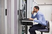 Man maintaining the servers in data center