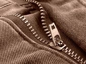 foto of zipper  - sepia toned denim fragment with zipper - JPG