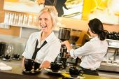 picture of enthusiastic  - Waitress serving coffee cups making espresso woman cafe bar working - JPG