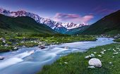 River in mountain valley at the foot of  Mt. Shkhara. Upper Svaneti, Georgia, Europe. Caucasus mount