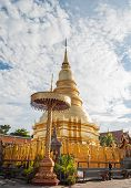 picture of hari  - Phra That Hari Phunchai golden pagoda in thai temple at Lamphun Province northern Thailand - JPG