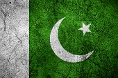 image of pakistani flag  - flag of Pakistan or Pakistani banner on rough metal background - JPG