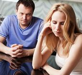 Conflict in couple. Problems in family. Sad man and woman