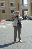 image of pio  - Elderly photographer tourist  in piazza Pio X11, Vatican city, Rome