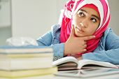 foto of muslim kids  - Beautiful Arabic Muslim girl reading on college - JPG