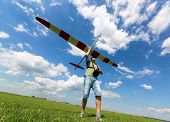 image of glider  - Man launches into the sky RC glider wide - JPG