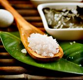 stock photo of spooning  - Spa Salt in wooden spoon closeup - JPG
