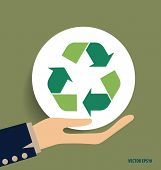 foto of reuse recycle  - Hand with Recycle symbol - JPG