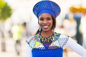 stock photo of traditional attire  - portrait of young african woman in traditional clothes - JPG