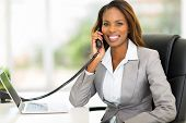 stock photo of people talking phone  - attractive african american office worker talking on the phone - JPG