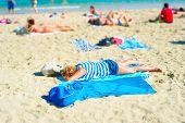 stock photo of bagpack  - People resting on the beach of Barcelona in the sunshine day - JPG