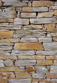 image of gneiss  - Colorful stone wall closeup in sunny day - JPG